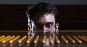 disturbi d'ansia - Businessman Staring at Row of Pencils --- Image by © Hans Neleman/Corbis